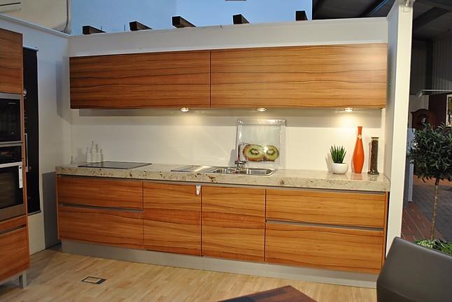 kornm ller musterk che grifflose k che mit hochwertigen furnier in indischen apfelbaum und. Black Bedroom Furniture Sets. Home Design Ideas