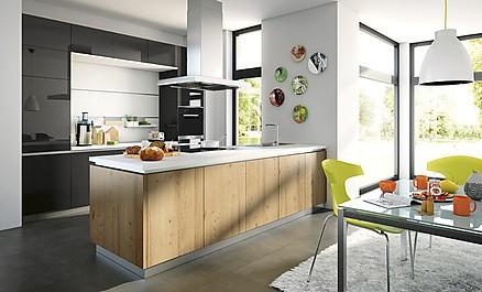 Modern und gemütlich zugleich - Grifflose Küche mit Kochinsel