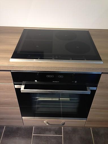 Häcker-Musterküche L-Küche mit Holzdekor und Dampfgarer